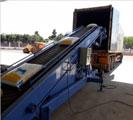 Băng tải chuyển hàng hóa xuống xe