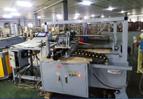 Máy cắt ống giấy tự động
