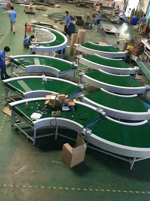 Băng tải rulo inox cong 90 độ
