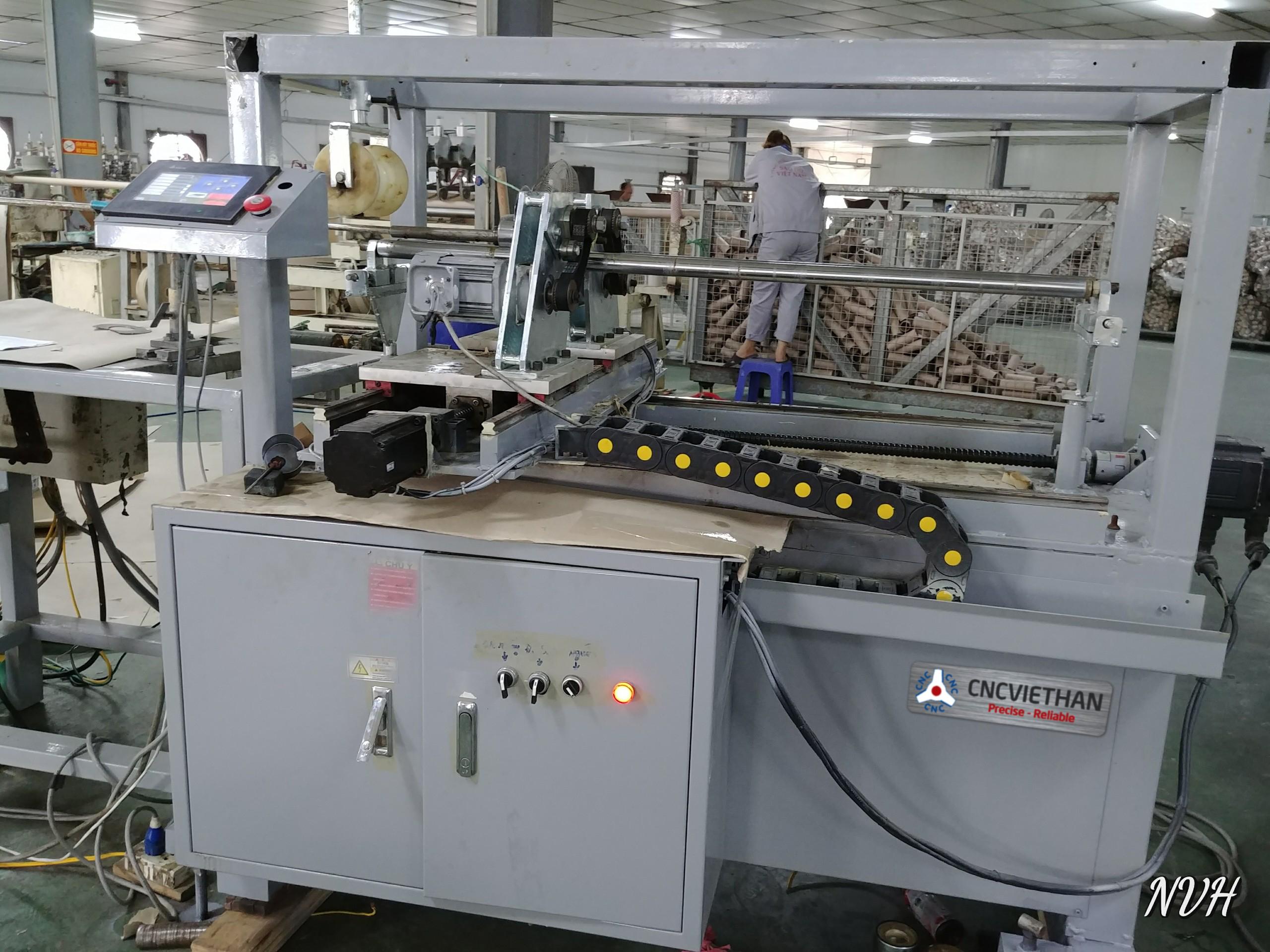 Máy cắt ống giáy tự động