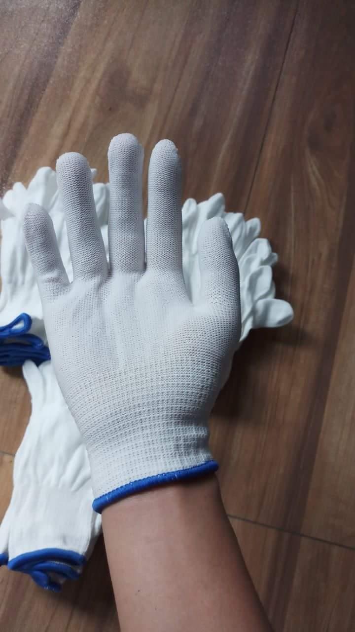 Găng tay mút trắng