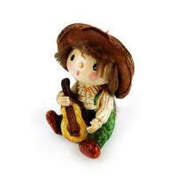 Cậu bé bù nhìn rơm và đàn violin