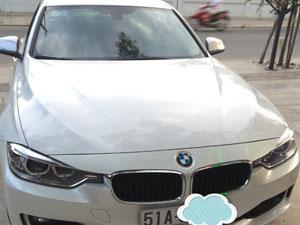 Xe BMW 320i trắng 4 chỗ